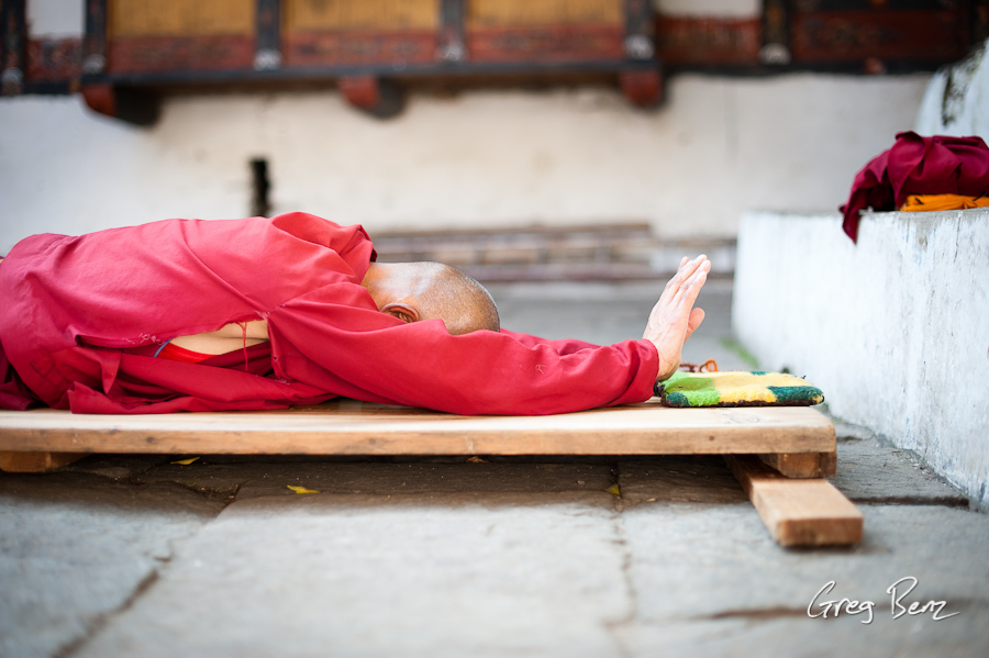 Bhutanese man performing prostrations