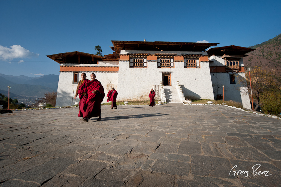 Bhutanese monks and temple