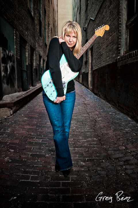 Woman Clutching Guitar in St Paul Alley
