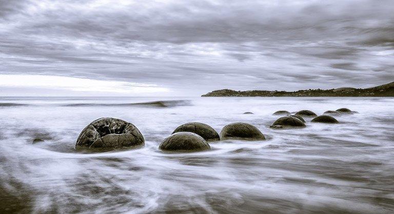 Moeraki Boulders in the misty waves