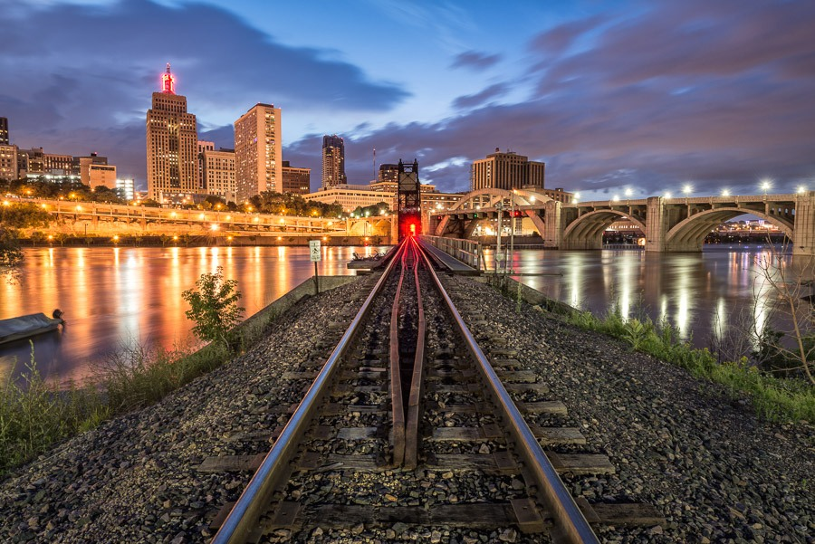 Railroad tracks, Mississippi River, and downtown St Paul at night.