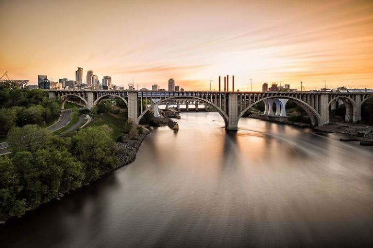 Minneapolis skyline and Miississippi River at Sunse