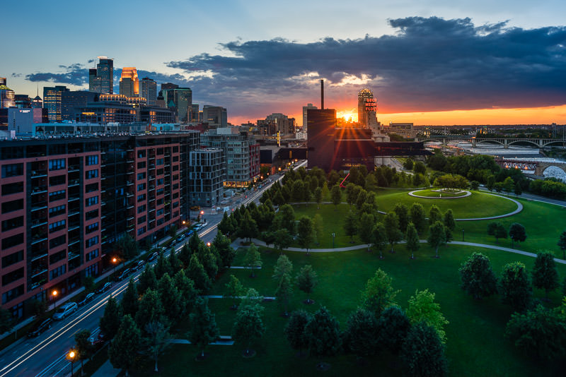 Sunset over the Guthrie Theater and Gold Medal Park against the downtown Minneapolis skyline
