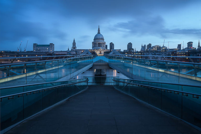 St Paul's Cathedral and the Millenium Bridge in London at the blue hour