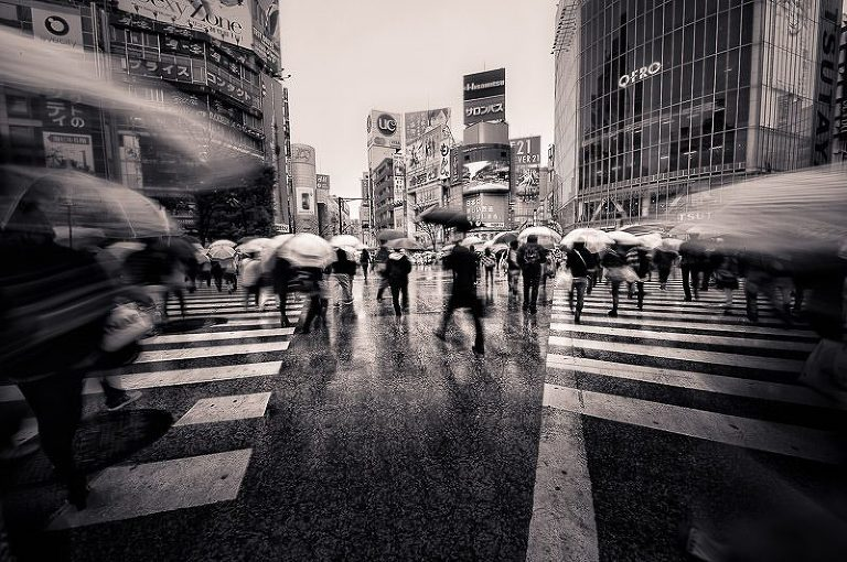 Black and white image of a busy, rainy day at Shibuya Crossing in Tokyo, Japan