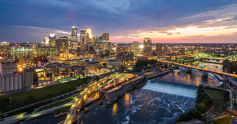 Downtown Minneapolis Skyline, the Stone Arch Bridge, and the Mississippi River at sunset
