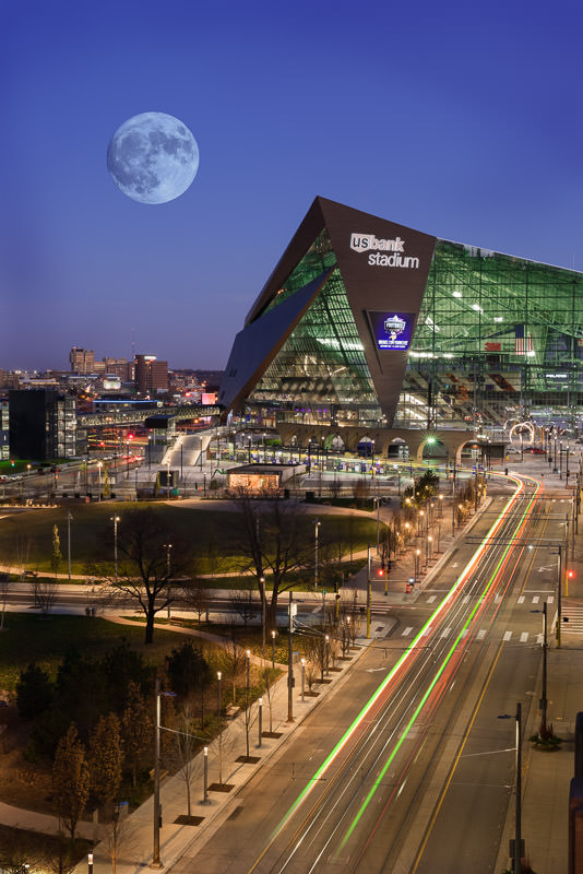 Moonrise over downtown Minneapolis and the Viking's stadium