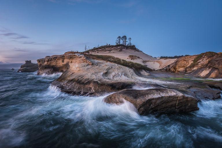 Waves crash into the rocky shoreline at Cape Kiwanda, Oregon